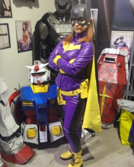 batgirl bat girl costume cosplay from batman dc comics, rubber mask and leather costume